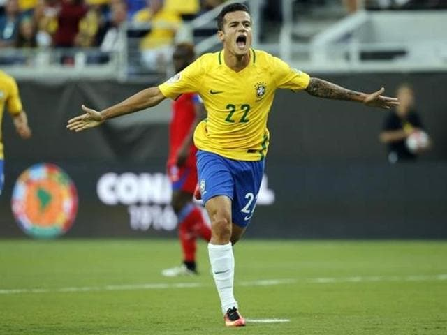 Brazil midfielder Philippe Coutinho (22) is congratulated by Lucas Lima (10) after he scored a goal against Haiti during the second half of the Copa America Centenario match at Camping World Stadium in Orlando on June 8, 2016.