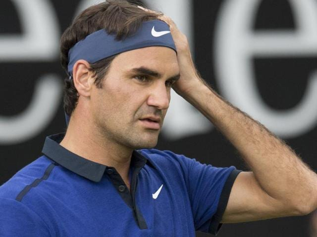 Switzerland's Roger Federer reacts during his round of sixteen match against Taylor Fritz from the USA in their round of sixteen match at the ATP Mercedes Cup tennis tournament in Stuttgart, Germany.