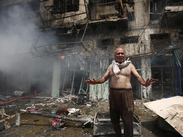 An Iraqi fireman sits after fire was extinguished at the site of car bomb attack in the mostly Shiite neighbourhood of Baghdad Jadida in the Iraqi capital.