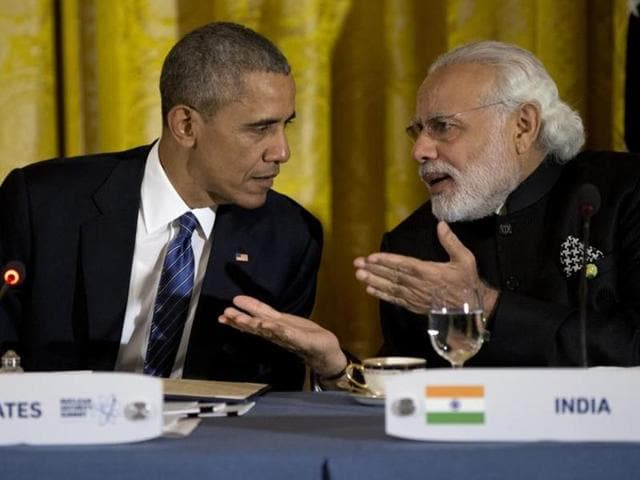 President Barack Obama talks with Prime Minister Narendra Modi during a working dinner with heads of delegations of the Nuclear Security Summit in the East Room of the White House in Washington on March 31, 2016.