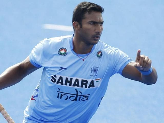 India's Raghunath Vokkaliga celebrates scoring the first goal during the Pool game between Germany and India.