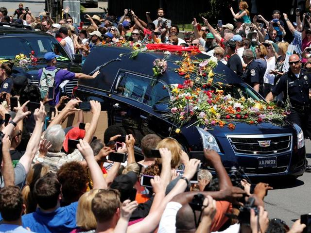 A hearse carrying the body of the late Muhammad Ali enters Cave Hill Cemetery in Louisville, Kentucky.