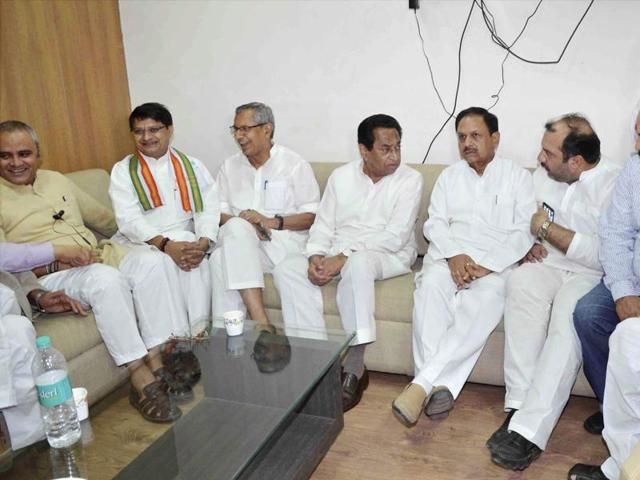 Congress leaders meet before the Rajya Sabha elections, in Bhopal on Thursday.