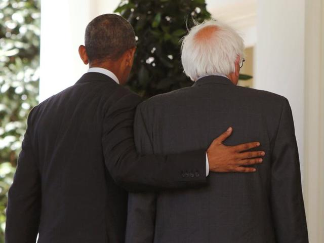 Democratic presidential candidate Bernie Sanders walks with US President Barack Obama to the Oval Office at the White House in Washington.