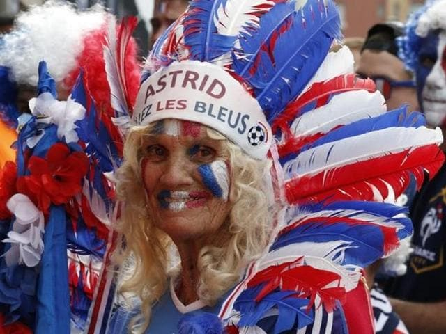 French football team's fans arrive at Stade de France stadium before Euro 2016 kicks off.