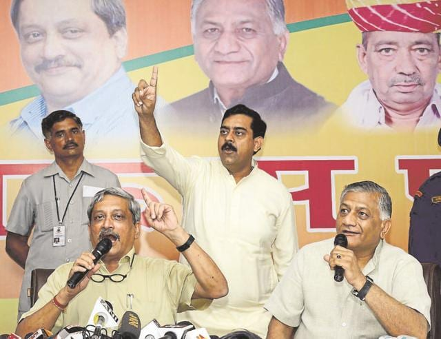 Defence Minister Manohar Parrikar (left) with General (retd) V K Singh (right) in Ghaziabad on Friday. The ministers' visit was to spread the word about the achievements of the Modi government over the past two years.