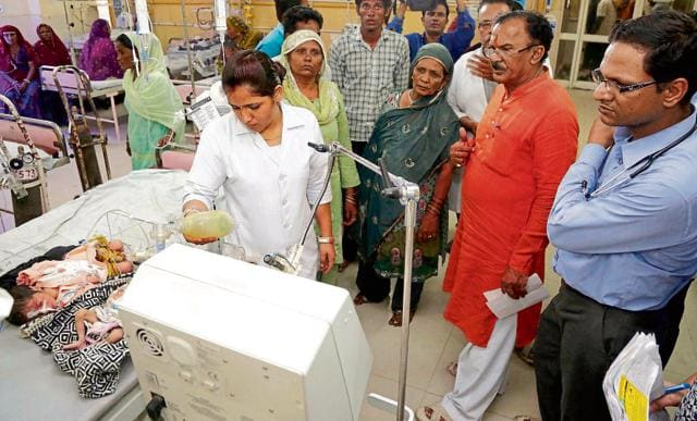 State education minister Vasudev Devnani visited children at Ajmer's government-run Jawahar Lal Nehru hospital after 16 newborns died  between May 15 and 25.