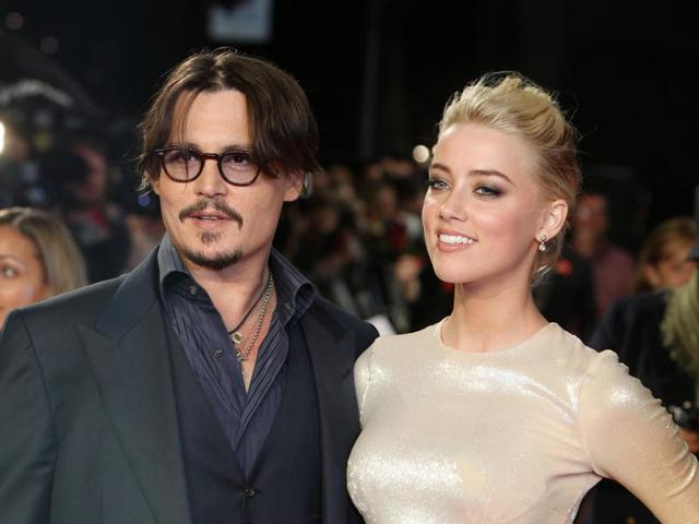 In this file photo, Johnny Depp and Amber Heard arrive for the European premiere of their film, The Rum Diary. Heard filed for divorce from Depp, citing irreconcilable differences.