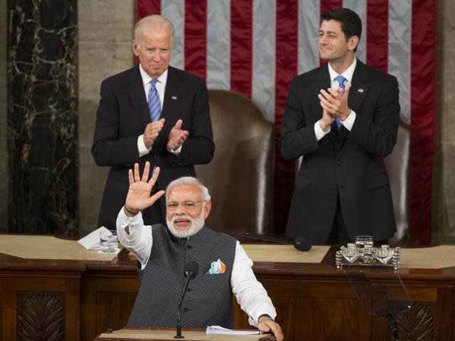 US vice-president Joe Biden and House Speaker Paul Ryan of Wis. applaud Indian Prime Minister Narendra Modi during his address to a joint meeting of Congress on Capitol Hill in Washington, Wednesday.