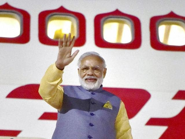 Prime Minister Narendra Modi waves upon his departure from Mexico City in Mexico on Wednesday night.