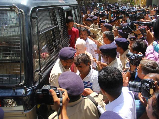 Convicts in Gulbarg Society massacre case seen coming out of the police vehicle for the hearing in Ahmedabad.