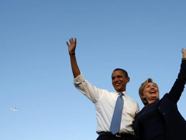 Barack Obama and Hillary Clinton wave at a campaign rally in Orlando, Florida, October 20, 2008.