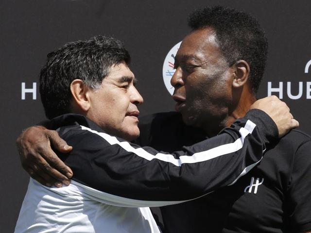 Pele and Maradona embraced during the five-a-side exhibition game in a sign that they have drawn a line under their long-running feud.
