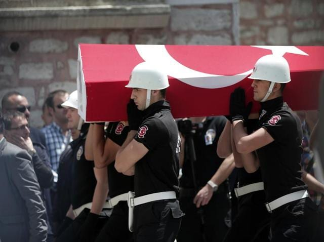 Turkish police officers carry the coffin of a slain police officer, one of the victims of Tuesday's explosion, during a funeral procession at Fatih mosque in Istanbul.