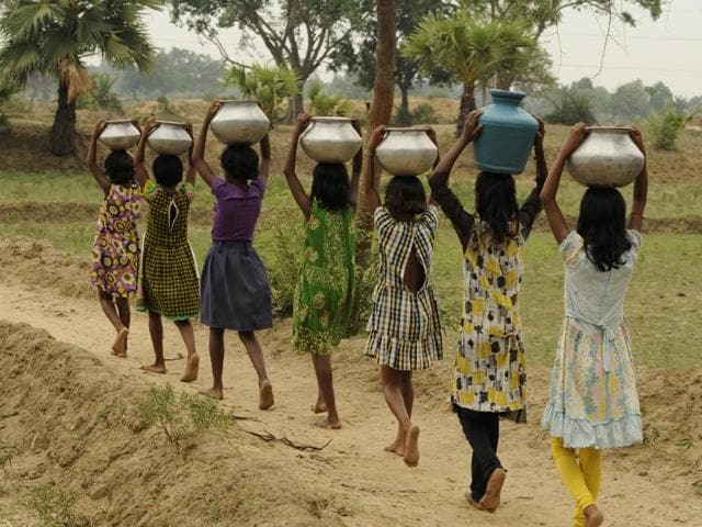 Villagers have to travel for a distance of over 1.5 km every day to fetch water for their daily   requirements.