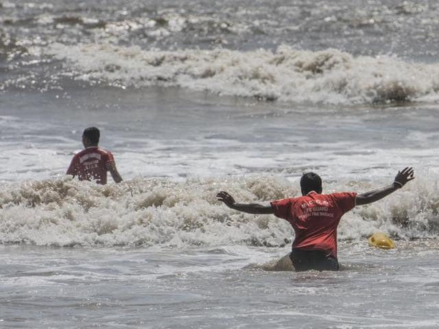 Indian Coast Guard officials at Juhu beach. HT photo