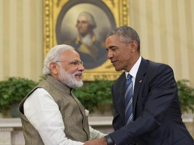 US President Barack Obama and Prime Minister  Narendra Modi shake hands before their meeting in the Oval Office of the White House in Washington.