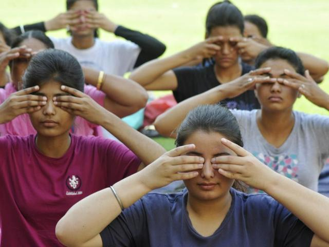 Chandigarh, India June 01 ::: Students and others taking part in Yoga camp at their college Guru Gobind Singh College sector 26 , on Wednesday, June 01, 2016 Photo by Karun Sharma/ Hindustan times