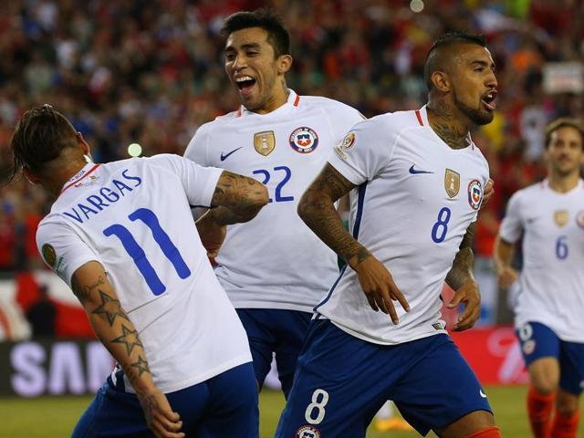 Arturo Vidal scores the controversial penalty for Chile's winner.