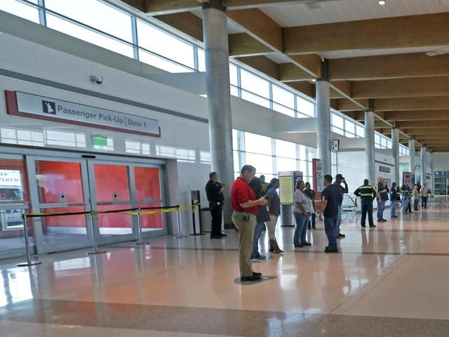 The baggage claim area remains shut down due to an officer involved shooting at Dallas Love Field airport on Friday.