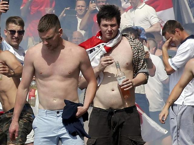 England supporters throw projectiles among tear gas at the port of Marseille before the game.