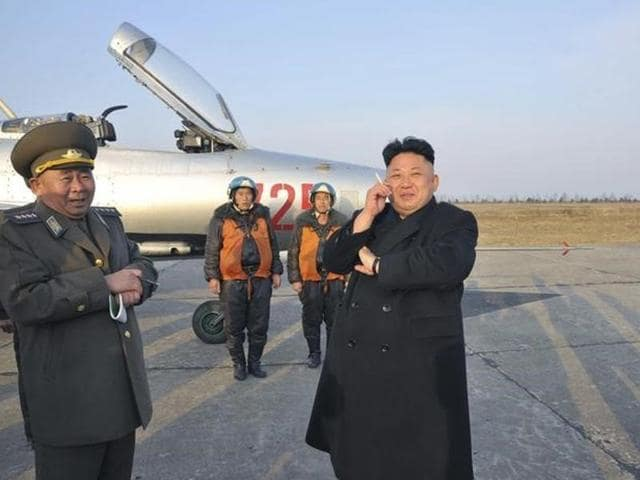 North Korean leader Kim Jong-Un smokes a cigarette as he attends a flight exercise of the KPA Air and Anti-Air Force Unit 188 in Pyongyang in this undated photo.