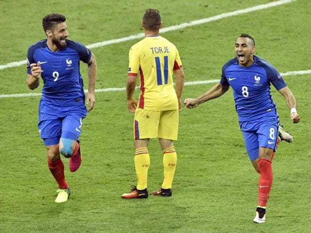 France's players celebrate after their last-gasp win over Romania.