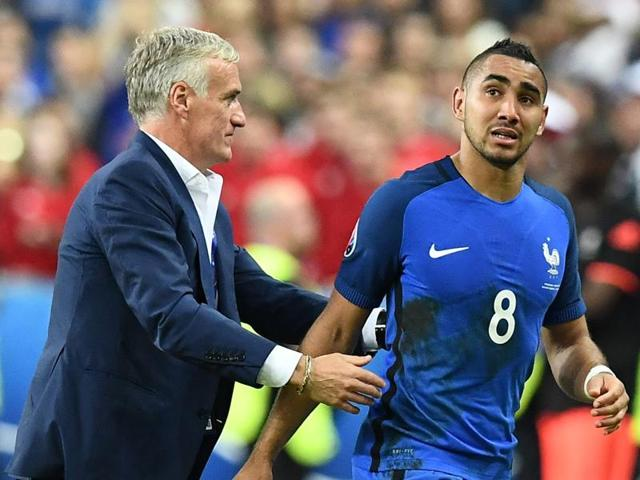 Dimitri Payet (R) is congratulated by coach Didier Deschamps after scoring the winning goal against Romania.