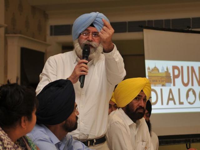 AAP senior leader HS Phoolka addressing the gathering during the Punjab Dialogue near Phagwara on Friday.