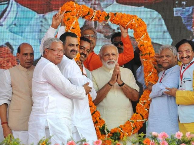 Saharanpur, India — May 26, 2016: Bharatiiya Janata Party workers garlanding Prime Minister Narendra Modi at a rally to mark the second anniversary of the formation of his government at the centre, in Saharanpur, India, on Thursday, May 26, 2016. (Photo by Ashok Dutta/Hindustan Times)