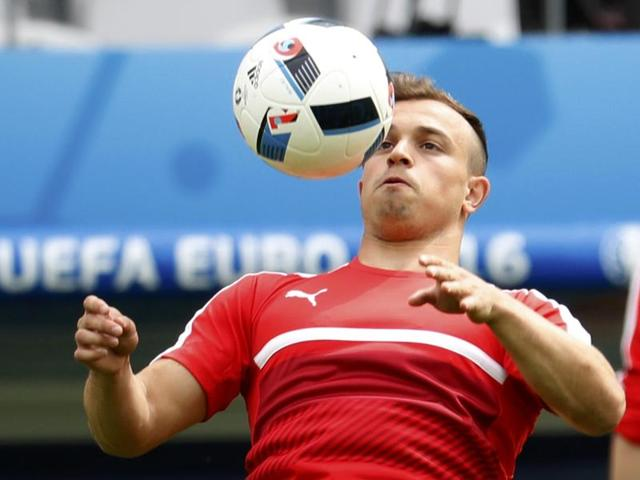 A combination of two file pictures shows Switzerland's Xherdan Shaqiri, left, and Albania's midfielder Lorik Cana. Switzerland face Albania in their first Euro 2016 group A match in Lens on June 11, 2016.