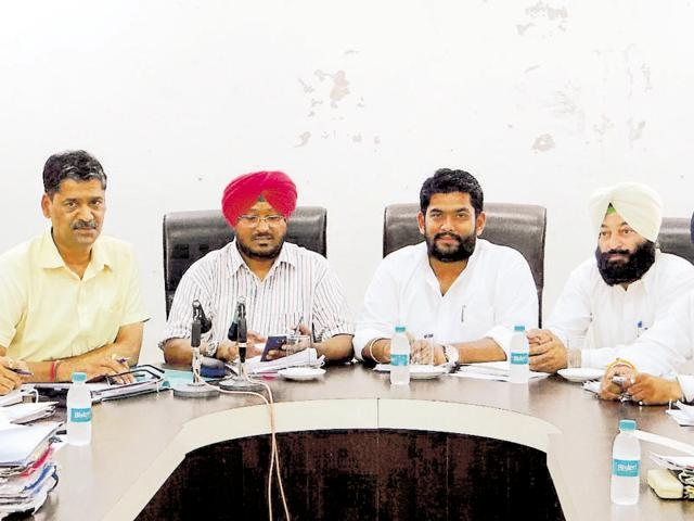 Deputy commissioner-cum-municipal commissioner Kuldeep Singh Vaid (second from left) at a meeting in Moga on Friday.
