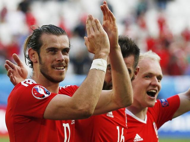 Wales' Gareth Bale (L), Joe Ledley (C) and Jonathan Williams celebrate at the end of the match.