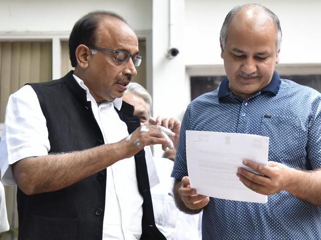 Vijay Goel and Delhi Education Minister Manish Sisodia in New Delhi on Saturday.