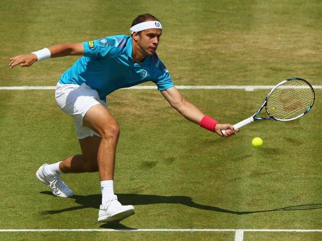 Muller slammed down 22 aces to 21 by the towering Karlovic.