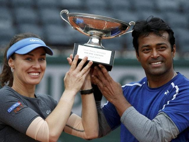 Switzerland's Martina Hingis, left, and India's Leander Paes hold the trophy after winning the mixed doubles final of the French Open.