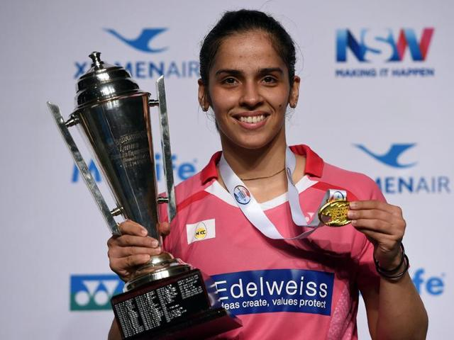 Saina Nehwal kisses the winner's trophy after overcoming China's Sun Yu for her first title of the season at the Australian Super Series.