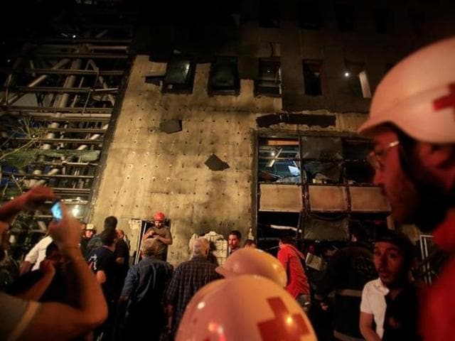 Red Cross members work at the site of an explosion at Blom Bank in Beirut, June 12, 2016.