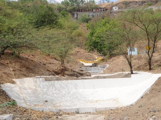 Boulder checks have been put in place to stop soil erosion at the hillock in Dewas.