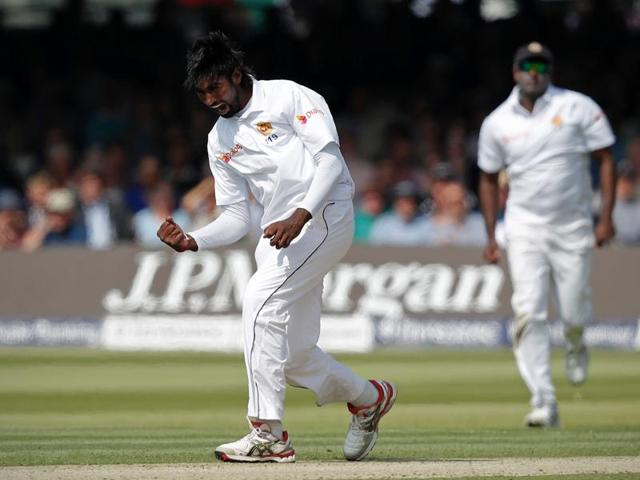 Nuwan Pradeep celebrates after bowling out James Vince.