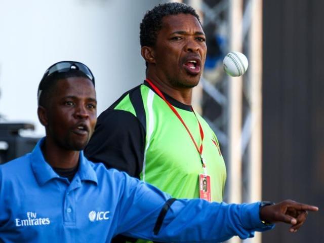 Zimbabwe's coach Makhaya Ntini (C) attends the first one-day international (ODI) match between India and hosts Zimbabwe.
