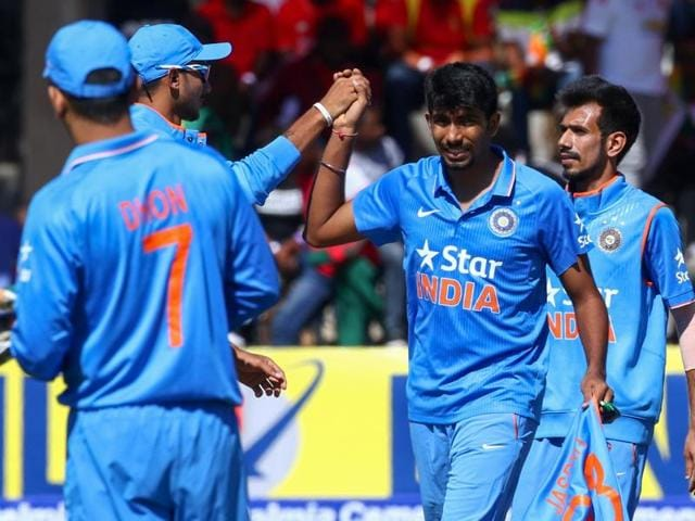 India's bowler Jasprit Bumrah (C) is congratulated by his teammates for taking four wickets.