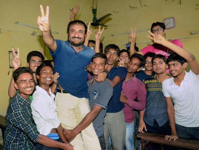 Successful students of 'Super-30' celebrate with their teacher Anand Kumar.