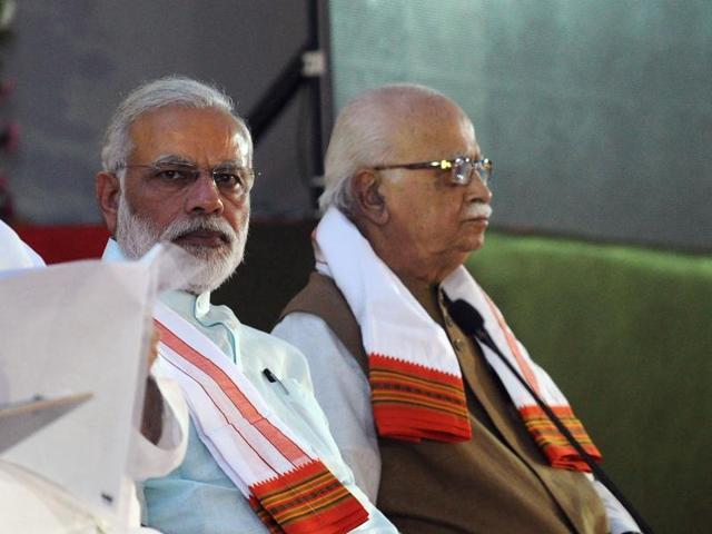 Prime Minister Narendra Modi (L) and Bharatiya Janata Party (BJP) senior leader Lal Krishna Advani attend the party's national executive meeting in Allahabad.