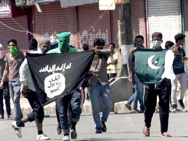 File photo of Kashmiri protesters displaying Pakistani and IS  flags during a protest against the alleged desecration of Jama Masjid by police in Srinagar, Jammu-Kashmir.