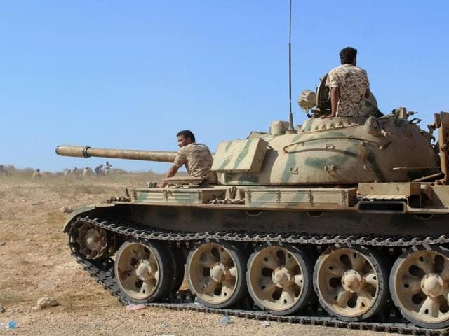 A tank belonging to forces aligned with Libya's new unity government is seen on a road as they advance on Sirte, Libya.