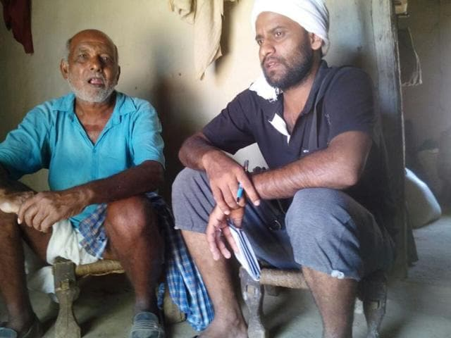 Narendra Bahadur Singh (right) with a local villager in Singrauli.