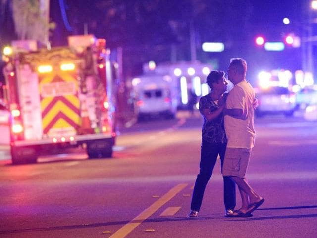 Family members wait for word from police after arriving down the street from a shooting involving multiple fatalities at Pulse Orlando nightclub in Orlando, Florida.