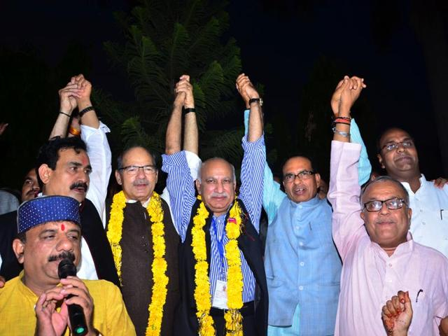 BJP candidates Anil Madhav Dave and MJ Akbar celebrate after winning the Rajya Sabha elections.