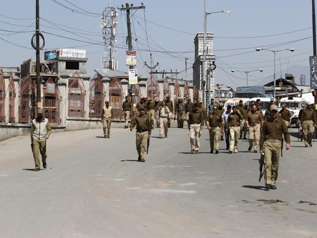 In this file photo, policemen can be seen patrolling a street inSrinagar in the militancy-hit Jammu and Kashmir.